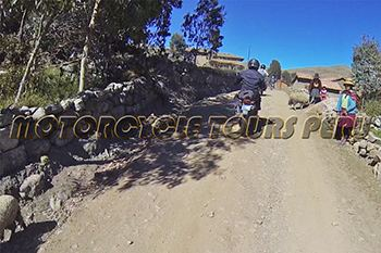 Motorcycle tour to Machu Picchu and Manu, colorful Andean village